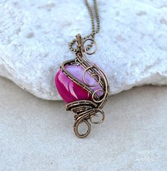 A unique gift for Christmas or Valentines Day!    Heart shaped Agate pendant in fuchsia and gunmetal.    It is hand crafted by me and it is one of a kind!