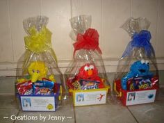 Here is his center piece. The basket is filled with one Sesame Street character. Added 3 different kind of Nabisco cookies snack bag such as Oreo, Nutter Butter, Teddy Grahams, Chips Ahoy, and Putter Butter Ritz Bits. Put a Thank you label put it in a basket plastic bag got from GBC and added a ribbon to match it with the color of the character.