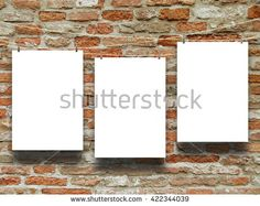 #Stock #photo: #three #blank #frames hanged by #pegs #against #orange #weathered #brick #wall #background