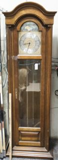 HOWARD MILLER GRANDFATHER CLOCK IN SOLID MAHOGANY CASE. THE FRONT OF CASE IS BEVELED GLASS, WITH A BEAUTIFUL SILVER AND GOLD COLOR FOR FACE OF CLOCK. MEASURES 76 IN. TALL.