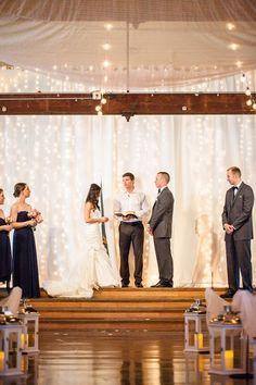 Elegant barn wedding with royal blue details close to Salem Oregon. Twinkle light backdrop