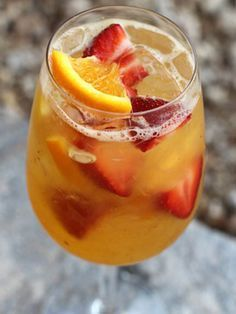 moscato minuet | 1 oz Grand Marnier 2 strawberries, sliced 1 orange wheel 4 mint leaves 1 oz orange juice 4 oz Moscato Lemon squeeze Directions: Combine ALL the ingredients in a cocktail shaker. Top with ice and shake vigorously. Pour contents into a wine goblet and serve.