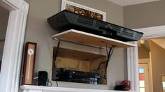 All cords an devises hidden behind the tv! No tv stand needed. Genius!