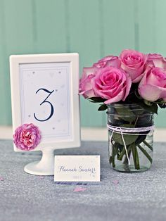 DIY Wedding Invites: Simple and sweet. Download and print our free table number designs then frame them for a pretty presentation. The place cards are customizable so you can fill out your guests' names and specify their table.  Click here.