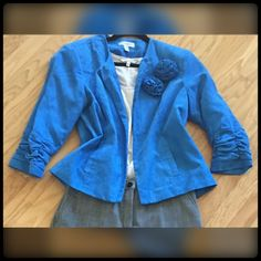 Turquoise Blue Jewel Neck Blazer Gently worn a few times.  This dry clean only jacket will look lovely paired with the matching dress pant that I'm listing next.  Has pockets on each side. Studded rosettes are pins that can be removed. So pretty & feels comfy on. Rouched sleeves. Dress Barn Jackets & Coats Blazers