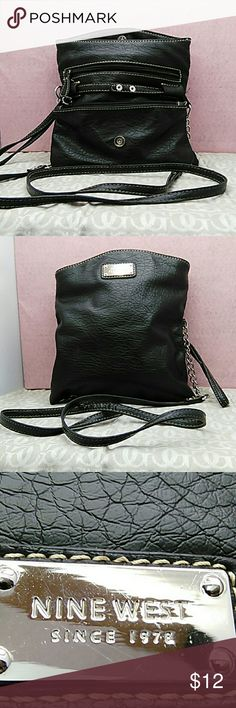 NineWest cross over bag. Smallish little black bag with long and short handle. Purse has two sections, folds over, top snap. NineWest Accessories