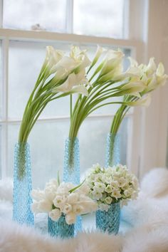 {light blue vintage glass and blue vintage mercury glass/flowers: white calla lilies, white narcissus aka paper whites, white tulips}