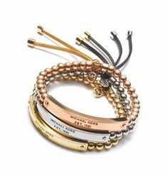 Macys   Michael Kors: Take a street chic approach to arm candy: