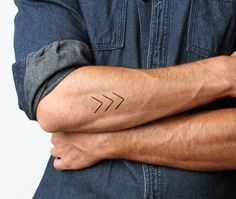 Man With Arrow Tattoos On Forearm