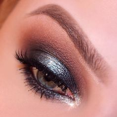 """A smokey, sparkly New Year's Eve look ✨ using @anastasiabeverlyhills single shadows, """"orange soda"""" as transition, """"sienna"""" on the crease, """"midnight"""" on the outer and inner kid, """"mermaid"""" and """"icy"""" on the center ✨ """"Noir"""" on the lower lash line, metallic luster liner in """"silver"""" on the tear ducts, @nyxcosmetics """"crystal Aqua"""" glitter liner on The center, ✨ @sweetheartlashes in """"honey"""" ✨ brows #dipbrow in """"taupe"""" and"""