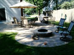 Paver patio with fire pit and grill surround.  Custom designed and built by Archadeck of Chicagoland.