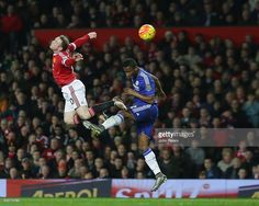 Wayne Rooney of Manchester United in action with Jon Obe Mikel during the Barclays Premier League match between Manchester United and Chelsea at Old Trafford on December 28, 2015 in Manchester, England.
