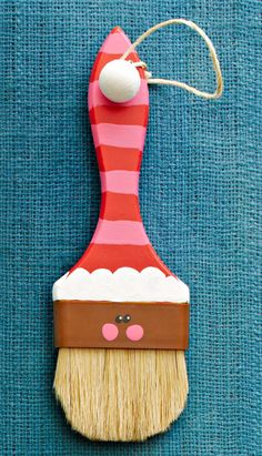 from Lowes Creative ideas:  Paintbrush Santa ... I'd make other faces and use old paintbrushes ... hang 'em in the workshop