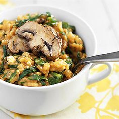 Meatless Monday: Spinach Feta Risotto  -  This creamy vegetarian risotto topped w/ sautéed mushrooms is perfect for a chilly spring day.