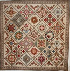Beautiful quilt created by Di Ford and inspired by an antique quilt of about 1840