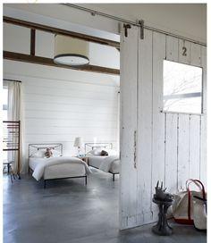 White barn doors. Stained cement floors.