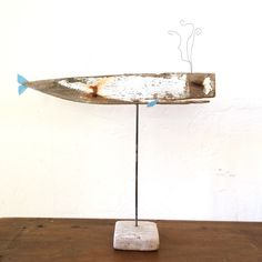 A personal favorite from my Etsy shop https://www.etsy.com/listing/237843545/whimsical-driftwood-whale-statue