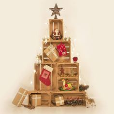 There are 9 of our wonderfully versatile apple crates in this high arrangement which is an amazing alternative to a Christmas tree. Wooden Crates Christmas, Christmas Eve Crate, Real Christmas Tree, Alternative Christmas Tree, Xmas Tree, Christmas Tree Decorations, Christmas Crafts, Christmas Ornaments, Holiday Decor
