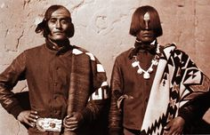 """Patricio Calabaza, left, wears a Navajo blanket, and Rafael Lobato, right, wears a Pendleton blanket, at the Santo Domingo Pueblo, circa 1930. Photo by Witter Bynner, courtesy of Museum of New Mexico, via """"Language of the Robe."""""""