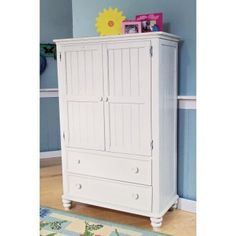 Olivia's armoire looks like this. Thinking of turning it into craft storage or computer cabinet.