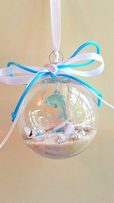 Aqua dolphin christmas ornaments with sand and by beachseacrafts