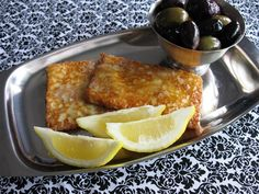 Saganaki - splash some brandy on it and set it on fire!  Opa!   Flaming cheese :D