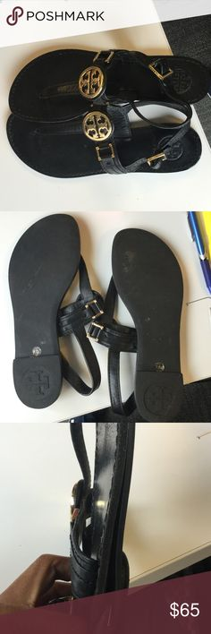 Tory Burch Leather T-Strap Sandals Black leather Tory Burch T-Strap sandals with black stitching and gold-tone logo emblem. Heel on right sandals is coming apart a bit (see pic), but it's nothing that can't be fixed with a little glue. In good condition overall. Does not come with box, just shoes. Tory Burch Shoes Sandals