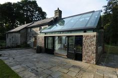 You can apply our scellant/ protector on porous surfaces, natural or artificial stones. Photo: Trombé :: Contemporary Modern Conservatories and Conservatory Design London :: Structural Glazing Architecture Durable, Architecture Design, Natural Architecture, Moderne Lofts, Modern Conservatory, Glass Extension, Glass Roof, House Extensions, Stone Houses