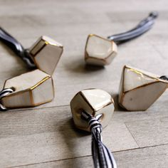 These small porcelain crystals hang from a black and white satin ribbon, and are a perfect little gift for the holidays.  The facets shine with a gold outline on each edge.  It's a little something beautiful that can come out every holiday season, or just hung around the house.