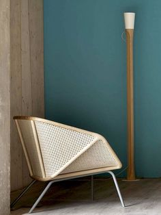 http://www.dezeen.com/2014/02/22/colony-armchair-by-skrivo-mixes-steam-bent-wood-and-rattan/
