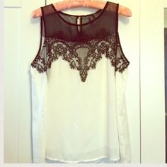 Beautiful black and white lace tank Gorgeous detail up top, I wore this once with a suit for an interview and I got the job! Perfect condition! Forever 21 Tops Blouses