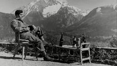 A paratrooper of the 101st Airborne Division enjoys a drink while lounging on the terrace of Hitler's retreat at Berchtesgaden after the end of the war. Although the German dictator was a lifelong opponent of alcohol, his private cellar was exquisitely stocked. The GIs who got there first held a 3-day binge with some of the most expensive bottles in the world at the time.