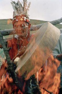 Shaman Kular MOKUR-OOL beats his dungur (drum) over fire as he blesses the arjan (sacred spring).