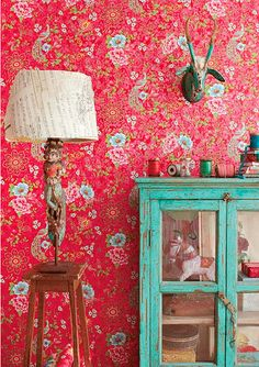 love this wallpaper...the vintage aqua cabinet...just says home to me...