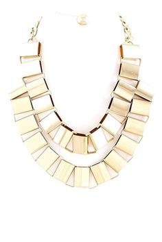 Complete your outfit with the gold colored box necklace, such a glamorous piece. www.majestical.com