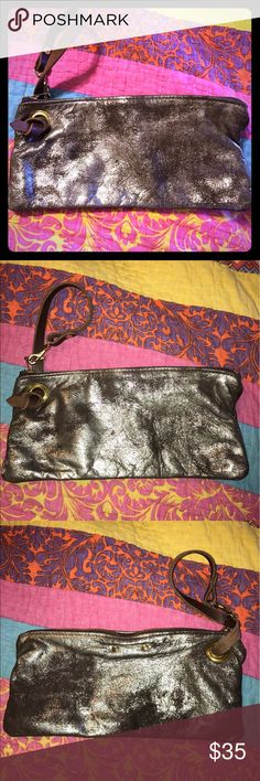 Distress Metallic Gold Wristlet Beautiful gold faded distress style. Excellent condition. Inside and out clean. By Elke Bags Clutches & Wristlets