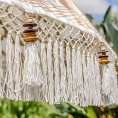Our gorgeous Liberace parasol. A white and gold garden umbrella hand-made in Bali for the East London Parasol Company. Perfect for those seeking shade from the summer sun.