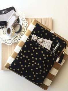 Pocket Planner Pouch - Gold dots on black   This pocket planner pouch is made from a print fabric. It features a front slip pocket, FOE pen holder and FOE (fold over elastic) back planner band. The inside zipper pouch space is roomy, and very ideal to hold washi tapes, page flags, stickers or anything else you can think of.  The Simbiosis Pocket Planner Pouch, is made from QUALITY quilting cotton fabrics, not cheap/thin grocery bag material. The Pocket Planner Pouch has reinforced stitch...