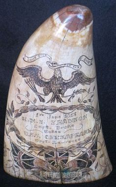 The back side of an old whales tooth with scrimshaw done by R.E. Spring of a naval battle between the USS Chesapeake and the HMS Shannon.
