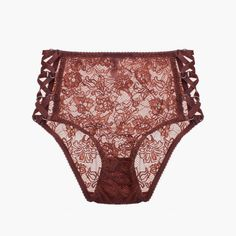 A soft and comfortable mid brief style in floral lace with beautiful extended lattice strapping at the sides - attatched with little silver rings.