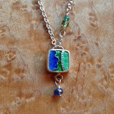 Cloisonne enamel necklace in sterling silver with semi precious accent beads. All four necklaces are available and I can make them any length. Currently they are 17 with a sterling silver lobster clasp.