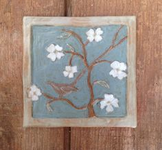 Handmade ceramic flower tile by Drumboden Tiles.