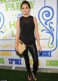 Hell for leather: Model Chrissy Teigen donned skin-tight trousers and a sheer top