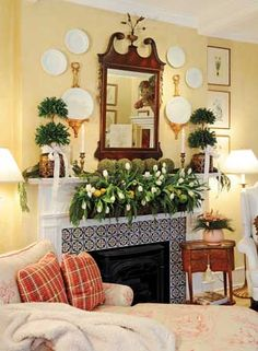 Mantel decorated for Christmas - love the symmetry, buttery walls with green, tulips, topiaries, plates on the wall - Betty Peachey and Randy Luken - Touch of Magic - Dayton