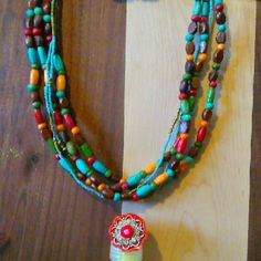 Jewelry set 3pc set. Matching layered wooden and glass beadwork necklace and bracelet. I'm included a free orange rhinestone ring. Ring is made from plastic.  Very colorful and fun!!!! Jewelry Necklaces