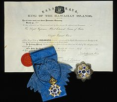 In 1881 King Kalakaua of Hawaii visited Great Britain as part of his world tour. Soon after his visit he bestowed Hawaiian orders on both Queen Victoria and the Prince of Wales. The Prince was appointed to the Royal Order of Kalakaua (shown here), founded by the King in 1875. His star and badge can be seen here alongside the warrant of appointment signed by King Kalakaua.  The Royal Collection © 2011, HM Queen Elizabeth II