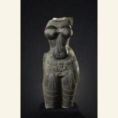 torso of female diety?  granite  1400-1600  Southern India