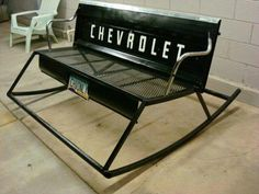 Back of pick-up truck upcycled into rocking bench. This would be perfect except with Ford instead!