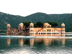 Taj Lake Palace, in the middle of Lake Pichola in Udaipur, is a gleaming homage to romance and indulgence.