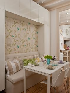 Ana Antunes' (Home-Styling) light, bright and modern breakfast room. Ikea Meltorp table. Fun bird and birdcage wallpaper!